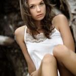 A beautiful girl near an old tree — Stock Photo #7651122