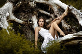 A beautiful girl near an old tree — Stok fotoğraf