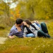 Portrait of a couple in love in autumn background — Stok fotoğraf