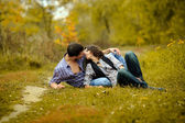 Portrait of a couple in love in autumn background — Stock Photo