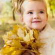 Autumn portrait of cute little caucasian girl — Stock Photo