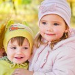 Little girls in autumn park — Stock Photo
