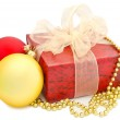 Gold and red christmas balls and box — Stock Photo