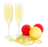 Christmas balls and glass of champagne — Stock Photo