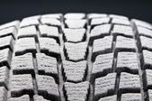 Close-up detail of winter tire snowed tread — Stock Photo