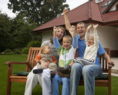 Happy family on the bench — Stock Photo