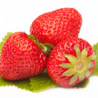 Three strawberries with leaf isolated on white — Stockfoto