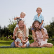 Happy family in the garden — Stock Photo