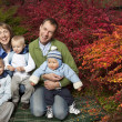 Happy family outdoors (in Autumn) — Stock Photo