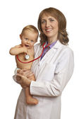 Doctor and smiling baby with stethoscope — Stock Photo