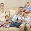 Family sitting on the sofa — Stock Photo #7724630