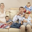 Family sitting on the sofa — Stock Photo