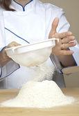 Flour sifting — Stock Photo