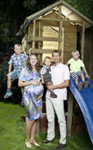 Family in front of children house — Stock Photo