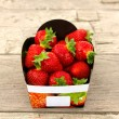 Strawberry Basket on table — Stock Photo