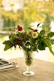 Beautiful bouquet on wooden table — Stock Photo