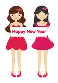 Cute girls with Happy new year letter board — Stock Photo