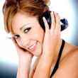 Fashion girl listening to music — Stock Photo #7568399
