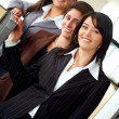 Female business team in an office — Stock Photo