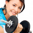 Fit girl lifting weights — 图库照片