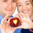 Apple of love - couple — Stock Photo #7568581