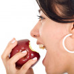 Girl biting an apple — Stock Photo #7568583