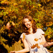 Autumn girl having fun - Stock Photo