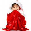 Baby santa in a gift sack — Stock Photo