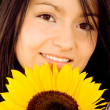 Beautiful girl with a sunflower — Stock Photo