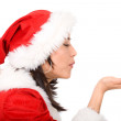 Female santa blowing her hand — Stock Photo #7568891