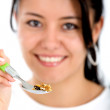 Girl eating healthy cereal - Stockfoto