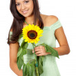 Casual girl with sunflower — Stock Photo #7568997