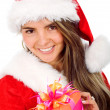 Female santa with a gift — Stock Photo #7569203