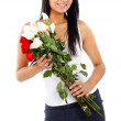 Beautiful girl holding flowers — Stock Photo
