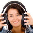 Girl holding headphones - Foto Stock