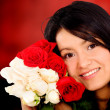 Beautiful girl holding roses — Stock Photo #7569336