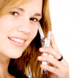 Beautiful girl on a mobile phone — Stock Photo