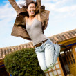 Happy girl jumping and smiling — Lizenzfreies Foto