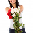 Beautiful girl holding flowers — Stock Photo #7569367