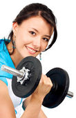 Fit girl lifting weights — Stock Photo