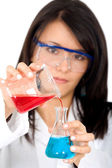 Female chemist mixing liquids — Stock Photo
