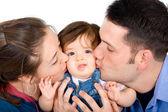 Family portrait kissing — Stock Photo