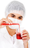 Female chemist with blood donation — Stock Photo