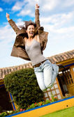 Happy girl jumping and smiling — Stock fotografie