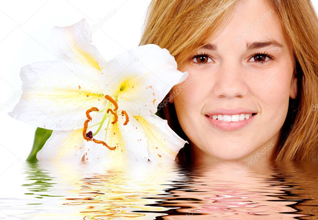 Healthy girl smiling portrait holding a lily flower next to her face - isolated over a white background — Stock Photo #7568368
