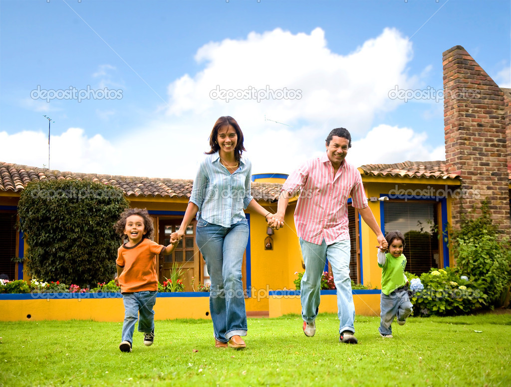 Happy family running and having fun outdoors smiling and enjoying — Stock Photo #7568371