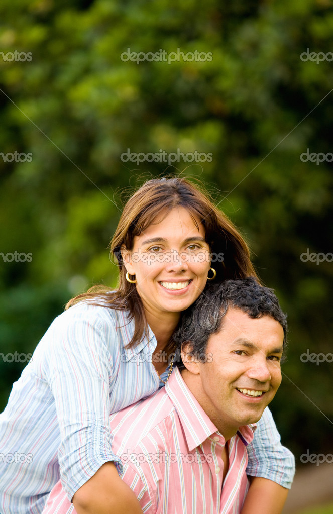 Happy and energetic couple portrait outdoors with plenty of copyspace  Stock Photo #7568379