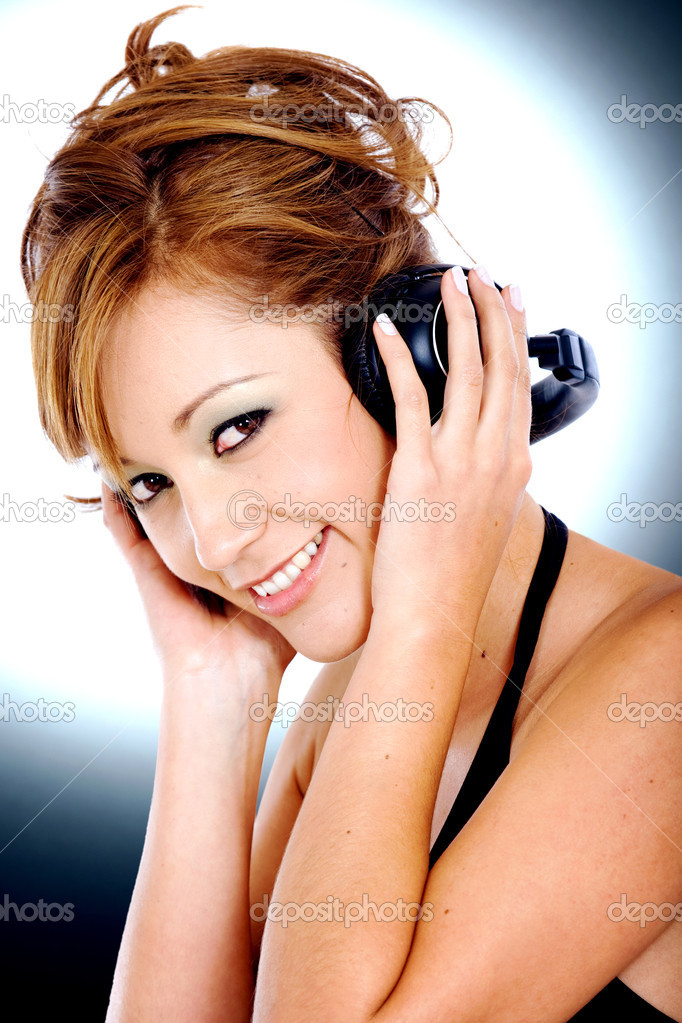 Fashion girl listening to music with headphones smiling  Stock Photo #7568399