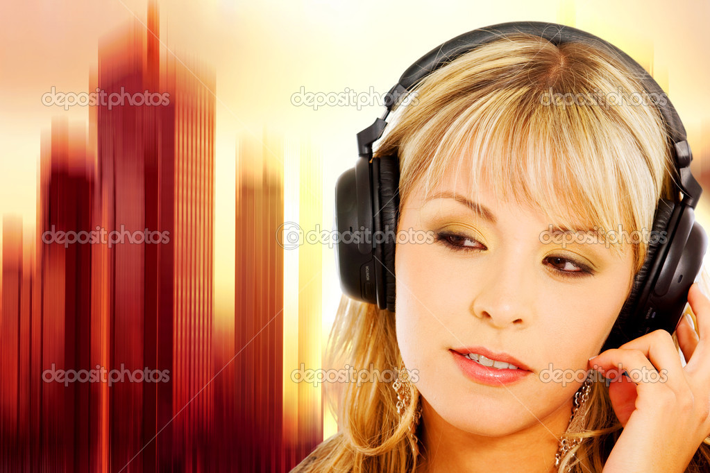 Blond girl listening to music on her noise cancelling headphones with a vibrant equalizer like background — Stock Photo #7568448