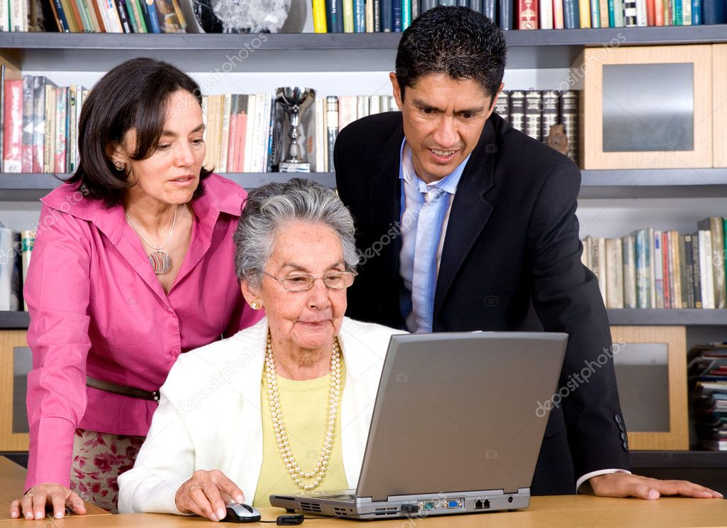 Adult online education concept using a family on a laptop computer at home — Stock Photo #7568464